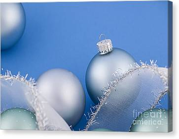 Christmas Baubles On Blue Canvas Print by Elena Elisseeva