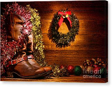 Christmas Cowboy Boots Canvas Print by Olivier Le Queinec