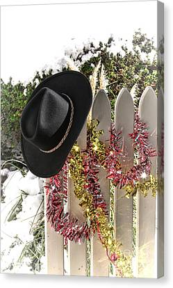 Christmas Cowboy Hat On A Fence Canvas Print by Olivier Le Queinec