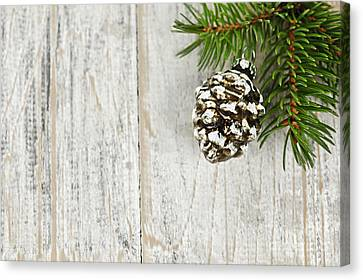 Christmas Ornament On Pine Branch Canvas Print by Elena Elisseeva