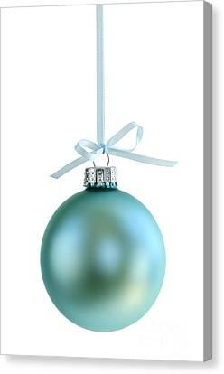 Christmas Ornament On White Canvas Print by Elena Elisseeva