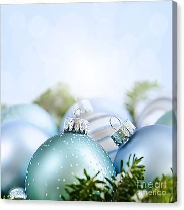 Christmas Ornaments On Blue Canvas Print by Elena Elisseeva