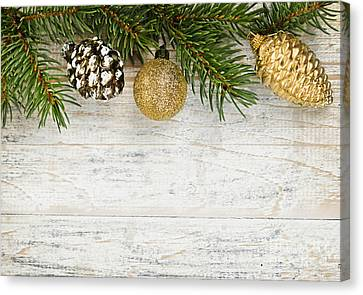Christmas Ornaments On Fir Branch Canvas Print by Elena Elisseeva