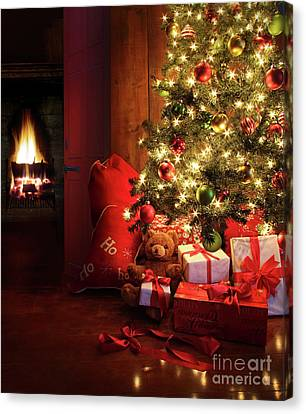 Christmas Scene With Tree And Fire In Background Canvas Print by Sandra Cunningham