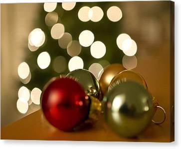Christmas Tree Bokeh And Ornaments Canvas Print by Mariola Szeliga