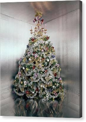 Christmas Tree Decorated By Gloria Vanderbilt Canvas Print by Ernst Beadle