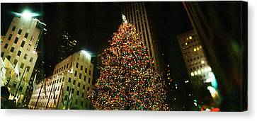Christmas Tree Lit Up At Night Canvas Print by Panoramic Images