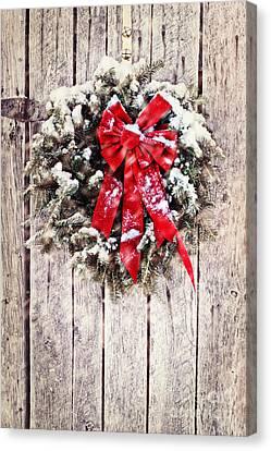 Snowy Night Night Canvas Print - Christmas Wreath On Barn Door by Stephanie Frey