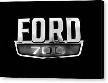Chrome Ford 700 Emblem Canvas Print by Tom Druin