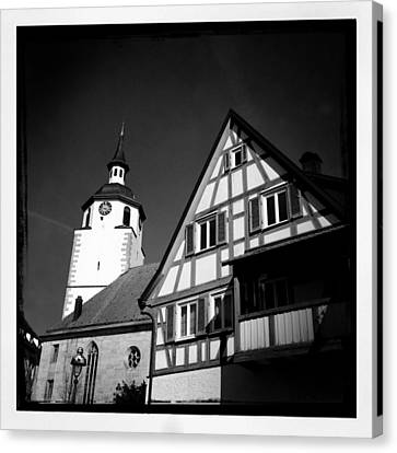 Church And Half-timbered House In Lovely Old Town Canvas Print by Matthias Hauser