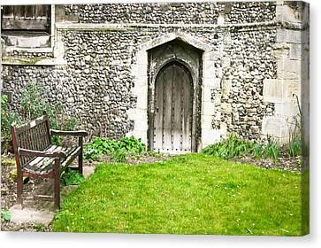 Medieval Entrance Canvas Print - Church Garden by Tom Gowanlock