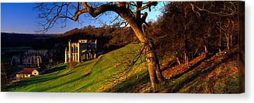 Church On A Landscape, Rievaulx Abbey Canvas Print by Panoramic Images