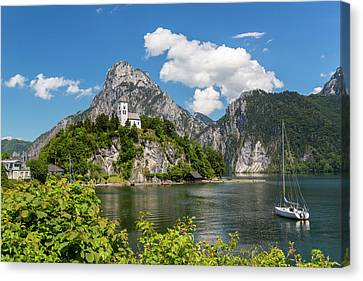 Church Overlooking Traunsee Lake Canvas Print by Peter Adams