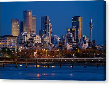 Canvas Print featuring the photograph city lights and blue hour at Tel Aviv by Ron Shoshani