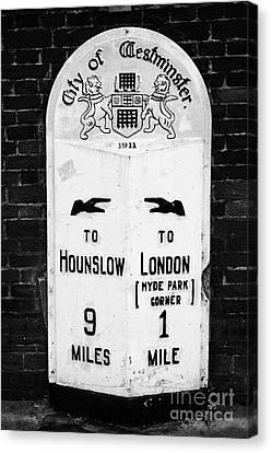 city of westminster old metal milestone between london and hounslow London England UK Canvas Print