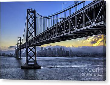 City Skyline Under The Bay Bridge Canvas Print by Peter Dang