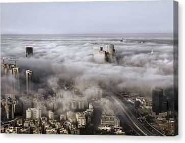 City Skyscrapers Above The Clouds Canvas Print by Ron Shoshani