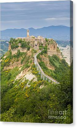 Civita Di Bagnoregio Tuscany Striking Position Atop A Plateau Of Canvas Print by Peter Noyce