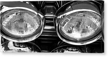 Classic Car Grill And Lights Canvas Print by Mick Flynn