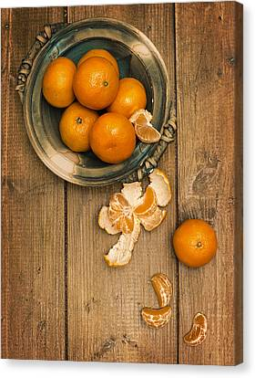 Clementines On Wooden Board Canvas Print by Amanda Elwell