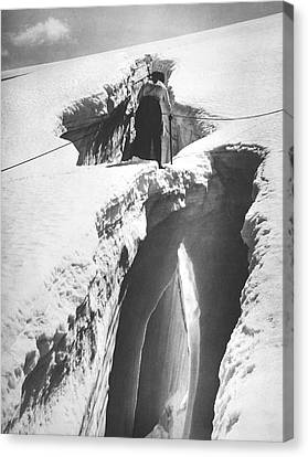 Climber Crossing An Ice Bridge Canvas Print by Underwood Archives