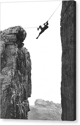 Climber Crossing On A Rope Canvas Print by Underwood Archives