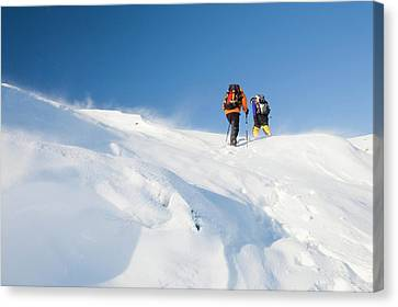 Climbers Being Blasted By Spindrift Canvas Print by Ashley Cooper