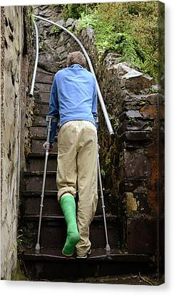 Climbing Steps On Crutches Canvas Print by Cordelia Molloy
