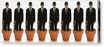 Clones Of Man In Business Suit Standing Canvas Print by Darren Greenwood