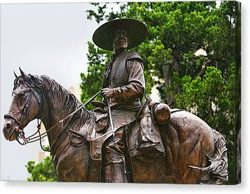 Close Bronze Sculpture Of Early Texas Cowboy Canvas Print by Linda Phelps