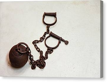 Close Up Of A Ball And Chain Shackles Canvas Print by Julien Mcroberts