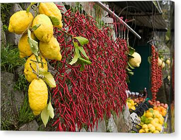 Close-up Of Lemons And Chili Peppers Canvas Print