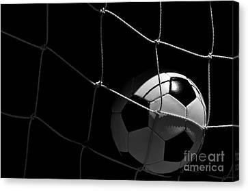 Closeup Of Soccer Ball In Goal Canvas Print