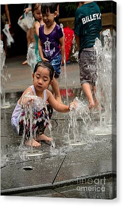 Clothed Children Play At Water Fountain Canvas Print
