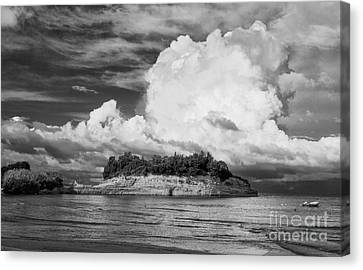 Cloud Boat And Cliffs On Corfu Canvas Print by Paul Cowan