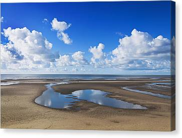 Clouds Across The Beach Canvas Print