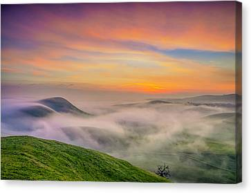 Clouds And Fog At Sunrise Canvas Print by Marc Crumpler