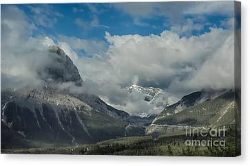 Clouds And Mist Over Canadian Rocky Mountain Peaks Canvas Print