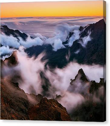 Clouds And Peaks Canvas Print by Babak Tafreshi
