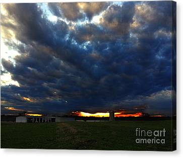 Clouds At Sunset Canvas Print by Lisa Holmgreen