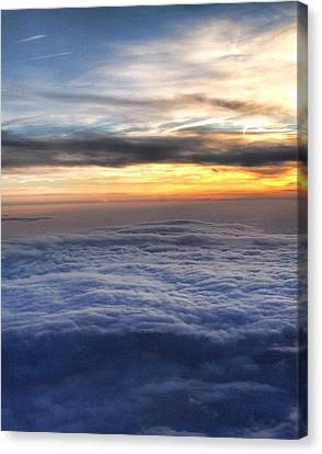 Clouds Canvas Print by Michael Fitzpatrick