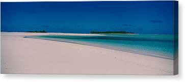 Clouds Over A Beach, Aitutaki, Cook Canvas Print by Panoramic Images
