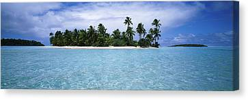 Clouds Over An Island, Aitutaki, Cook Canvas Print by Panoramic Images