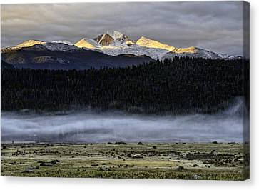 Clouds Over Longs Peak Canvas Print by Tom Wilbert