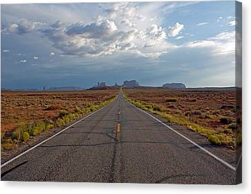 Clouds Over Monument Valley Canvas Print by Chris Flack Desert Images