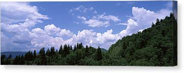 Clouds Over Mountains, Cherokee, Blue Canvas Print by Panoramic Images
