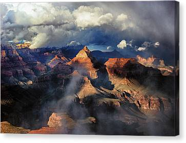 Clouds Part Over The Canyon Canvas Print by Brian Kerls