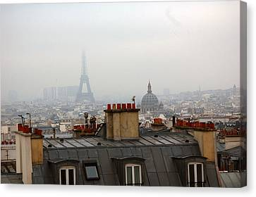 Cloudy Day In Paris Canvas Print by Peter Cassidy