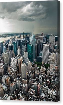 cloudy Manhattan Canvas Print by Hannes Cmarits