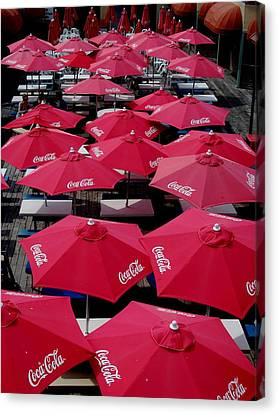 Coca Cola Red Umbrella's Canvas Print by Rick Todaro